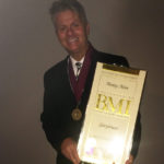 Monty Lane Allen wins BMI Songwriter Award for Glorybound with cowriter Robert Arthur